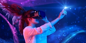 Person with long hair in a ponytail wearing a VR headset reaching out and touching an white light