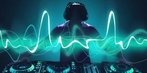 A DJ stood behind a sound decks